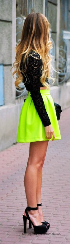 Street style - Neon flare skirt and black long sleeve lace top. Love the heels too! Oh, and her long curly hair is amazing. Brunette to blonde ombre is so pretty.