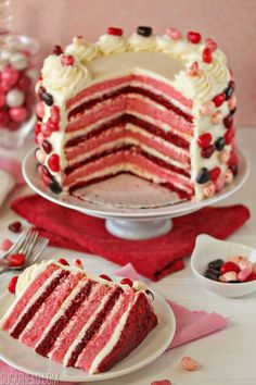 Sky-High Pink and Red Velvet Cake, with EIGHT layers of cake!   SugarHero.com