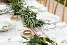 Jenni Kayne's birthday dinner tablescape // green centrepieces // greenery // white // gold // simple wedding reception