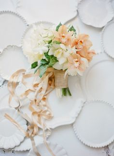 Peach and Ivory Orchid Bouquet | Jose Villa Photography on @bajanwed via @aislesociety