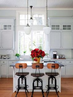 Simple white kitchen. Found on twistmyarmoire.com