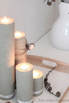 Use paper towel and toilet paper cores and fill with cement to create these neat candle pillars! ∙❉∙ DIY Candles