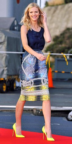BROOKLYN DECKER  The model-actress continues the Battleship press tour in Japan, choosing a navy tank, multicolored printed skirt and neon heels for an appearance on the USS George Washington.