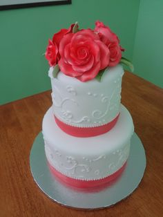 Paradise Pastries LLC - Hawaii Cake Bakers - Elegant pink and white wedding cake with fondant flower topper