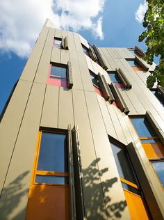 pleated golden aluminium facade by [BP] Architectures facing the Palce de la Bastille, Paris