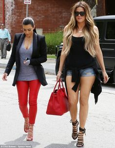 Leggy ladies: Kim wore red leather trousers while her younger sister was clad in tiny Dais... http://dailym.ai/1fc13YM#i-9bf10e33