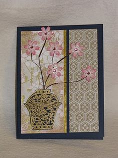 Asian motifs, soft colors and three dimensional flowers combine to create a card of simple, elegant beauty.
