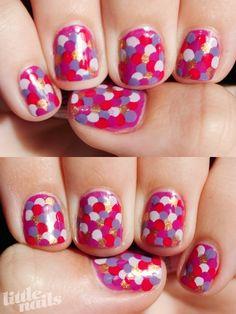 Overlapping polka dot nails.