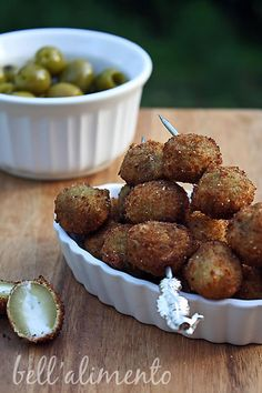 fried stuffed olives... 2 of my favorite things made into one dish. Stuffed bleu cheese olives would be perfect for this.
