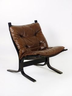 A bentwood laminate and leather chair, designed In