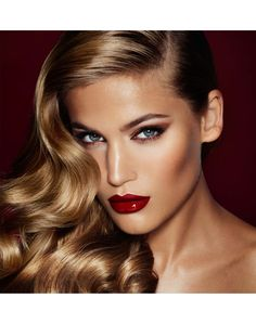 THE BOMBSHELL dark and lovely lips and well done eye makeup. The hair is spectacular as well.