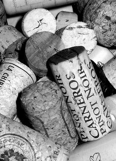 I'm seeing 12 corks in this picture. Write a short story / paragraph explaining the bottle of wine you opened, the company you were in and what you were celebrating (or trying to forget)