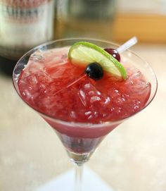 Tequila Smash. Tequila, lime juice, Luxardo Maraschino liqueur mixed with blueberries and homemade maraschino cherries (recipe included)
