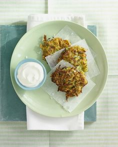 Zucchini-Scallion Fritters | Martha Stewart Living - Tired of the same old Super Bowl spread? Add these fritters to the mix. Zucchini, scallion, egg, and flour combine to form perfect patties fried to golden brown perfection and served with sour cream. Veggie Recipes, Vegetarian Recipes, Cooking Recipes, Veggie Snacks, Tapas Recipes, Vegetarian Options, Entree Recipes, Easy Recipes, Dinner Recipes
