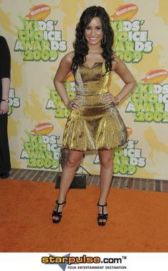 Demi Lovato at Nickelodeon's 2009 Kids' Choice Awards. Pauly Pavillion, Westwood, CA. Demi Lovato, Kids Choice Awards 2014, Destinations, Disney Channel, Peplum Dress, Branding Design, Photo Editing, Royalty Free Stock Photos, Actresses
