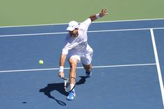 Brian Baker (USA) and Jan Hajek (CZE) play in the first round of the US Open. - Billie Weiss/USTA