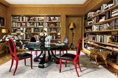 In Linda Pinto's Paris flat, the library/dining room features glamorous mirror-backed shelving. Description from architecturaldigest.com. I searched for this on bing.com/images