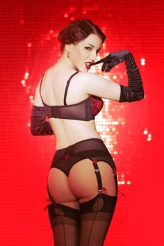 Burlesque, gloves, garters and sequined backdrop
