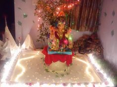 Get innovative, creative and fresh Ganpati decoration ideas and tips in here. Take a look at these cool ideas and learn how to do Ganpati decoration at home Ganesh Pooja, Ganesh Chaturthi Decoration, Ganpati Decoration At Home, Pooja Room Door Design, Ganpati Bappa, Pooja Rooms, Room Doors, Baby Photos, Birthday Candles