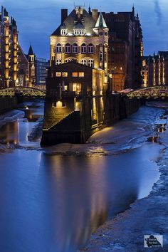 Water Castle, Hamburg, Germany. The many streams, rivers and canals in Hamburg are crossed by over 2300 bridges, more than those of Amsterdam and Venice combined.