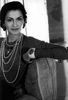 A lovely shot of Coco Chanel with perfectly layered accessories.
