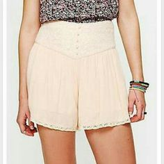 "Free People lace yoke high waist skort shorts Crochet high-waisted skort with crochet trimming around bottom hem. Button tab detailing down front. Stretchy smocked back of waist. Pleated detailing below waist that creates crinkled fabric effect. Fully lined.   *100% Rayon? *Dry Clean Only? *Import?  Measurements for Size Small:? Waist (all around - relaxed): 26""? Rise: 12 3/8""? Inseam: 3 1/2""  Size 6 NEW WITHOUT TAGS Free People Shorts"
