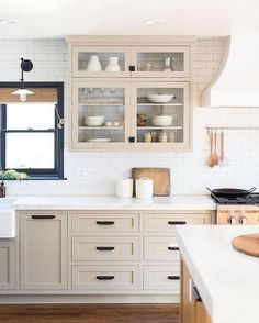 Non-white kitchens—putty/tan colored cabinets with black windows and marble ba… - Modern Kitchen Cabinet Interior, Refacing Kitchen Cabinets, Home Decor Kitchen, Kitchen Furniture, New Kitchen, Kitchen Design, Beige Kitchen Cabinets, Armoire In Kitchen, Kitchen Black