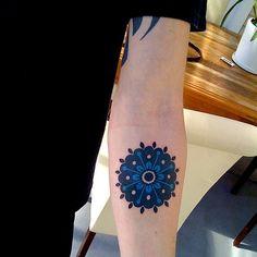 Blue Mandala Female tattoo