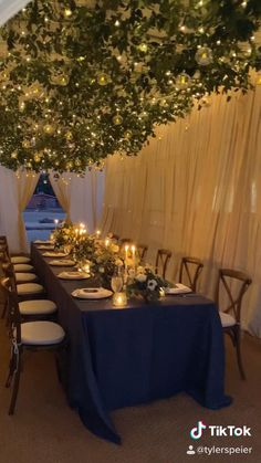 Complete transformation of metal horse barn to create a tiny wedding dinner with twinkle lights, hanging candles, hanging greenery, taper candles, navy blue linens, fine china, spanish tile place cards, and vineyard chairs. Designed by Tyler Speier. Outdoor Wedding Decorations, Wedding Centerpieces, Wedding Table, Diy 50th Party Decorations, Wedding Dinner, Dream Wedding, Small Wedding Decor, Rustic Wedding Backdrops, Outdoor Wedding Reception
