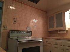 Wonderful pink tile kitchen in 1936 Fresno house