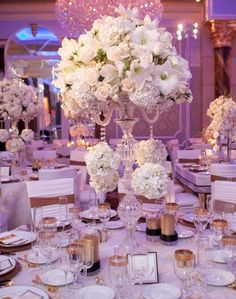 How about tall wedding reception centerpieces?! Such a #romantic decoration! Photo Credit: Josh Lynn Photography