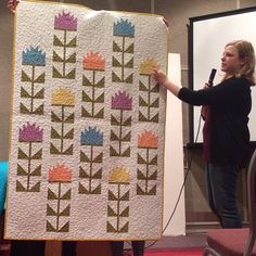@elizabethagh showing off her adorable Thistle quilt in #RhodaRuthFabric! #schoolhouse #RKatQM #QuiltMarket