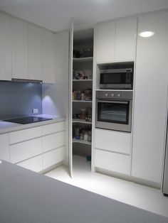 Kitchen Room:Design Furniture Curved Corner Rack Blended With Tiny U Shaped White Pantry Cabinet For Kitchen Witching Kitchen Outlook With Fabulous White Pantry Cabinets Inspiration 2017 Furniture Small Kitchen Spaces Mount Microwave Shelf above Stove