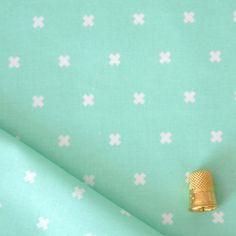 Tissu coton à motif croix vert menthe