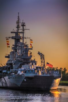 BB 55 USS North Carolina at Dusk - In honored retirement,  but still flying her battle flags on the Cape Fear river  Wilmington NC