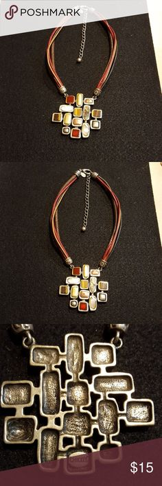 Chicos statement Necklace Pendant has Red,Brown,Gold Color & Multi Colored Stones. Necklace has Five Strands of Leather, Red, Brown, Light Brown &Black. Excellent condition. Chico's Jewelry Necklaces