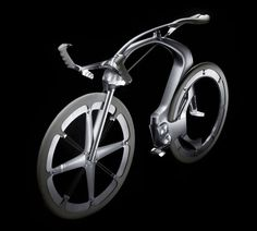 Peugeot's new design team just released these images of a concept bicycle dubbed the B1K.Ã'Â Sculpted as a race bike, it features a chainless drivetrain, carbon fiber construction and scant few details on the rest of the design. Click to enlarge the images…looks like we'll have to come up with a new term for tires.Ã'Â …