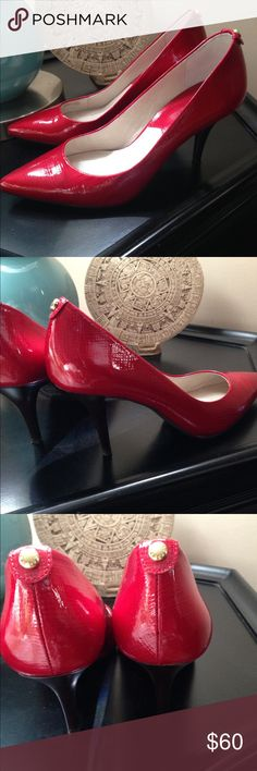 Michael Kors red pumps New, red leather pumps. Heel is approximately 2.5 inches high. Size is 6.5. Michael Kors Shoes Heels