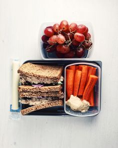 today's packed lunch is a tuna sandwich (chunk light packed in water mixed with plain greek yogurt and spicy mustard, red onion and mixed greens) on whole wheat, a cheese stick, carrots and hummus plus grapes