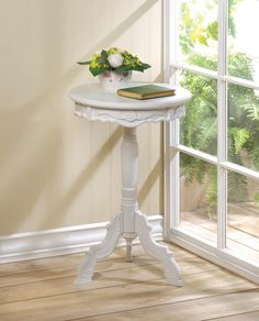 Mini Rococo Accent Table. Decorative small round white wood accent table. This stylish round white accent table will fit into small spaces and compliment any home decor in your home.