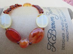 Check out 'gemstones to glamour jewellery' and this item in my Etsy shop https://www.etsy.com/uk/listing/120196490/gemstone-bead-bracelet-carnelian-stone