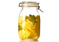 Peel and slice 1 pineapple. Combine in a large jar with one 750-ml bottle vodka and 2 mint sprigs. Let sit for at least 8 hours and up to 3 days (the flavor will grow stronger the longer it sits). Strain. Muddle strained-out pineapple and mint for drinks if desired.