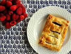 Raspberry Jalousies Recipe (serious eats) | In this breakfast sweet, each puff pastry is scored to allow a peek at the filling of sweetened cream cheese and fresh raspberries.
