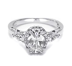 Tacori-Stylish and classic at the same time, snappy pear shaped diamonds make this diamond engagement ring soar. A crown of round diamonds bloom a beautiful oval center stone for sophistication and glamour.