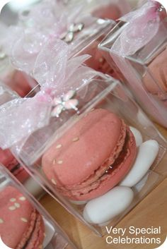 Christening bomboniere by 'Very Special Celebrations' - French macaron with sugared almonds, transparent box, ribbon and cross embellishment.