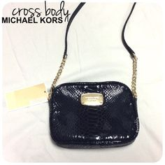 """authentic MICHAEL KORS hamilton cross body NEW with tags, never used and in perfect condition. patent snake like material with partial gold chain strap. perfect size to hold just the important things, grab and go.  height 4.5"""" length- 6.5"""" width 1"""" strap length- 51"""" / 24"""" drop   due to lighting- color of actual item may vary from photos.  please don't hesitate to ask questions. happy POSHing    use offer feature to negotiate price on single item  i do not trade or take any transactions off…"""