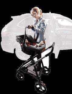 mother clicking alpha car seat onto buggy frame