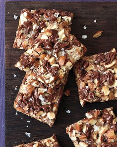 ---Salted Toffee-Chocolate Squares--- 13 graham crackers 1 bag (8 ounces) toffee bits 1 1/2 cups coarsely chopped toasted natural almonds 1/2 cup sugar 1 cup (2 sticks) unsalted butter 3/4 cup (4 ounces) bittersweet chocolate, chopped, or chocolate chips 3/4 teaspoon coarse salt