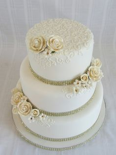 """50Th Wedding Anniversary 6""""+8""""+10"""". Gold gumpaste roses with buttercream hand piped swirls."""