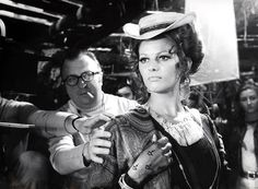 C'era una volta il west 1968 - Claudia Cardinale, with Sergio Leone in the background directing.